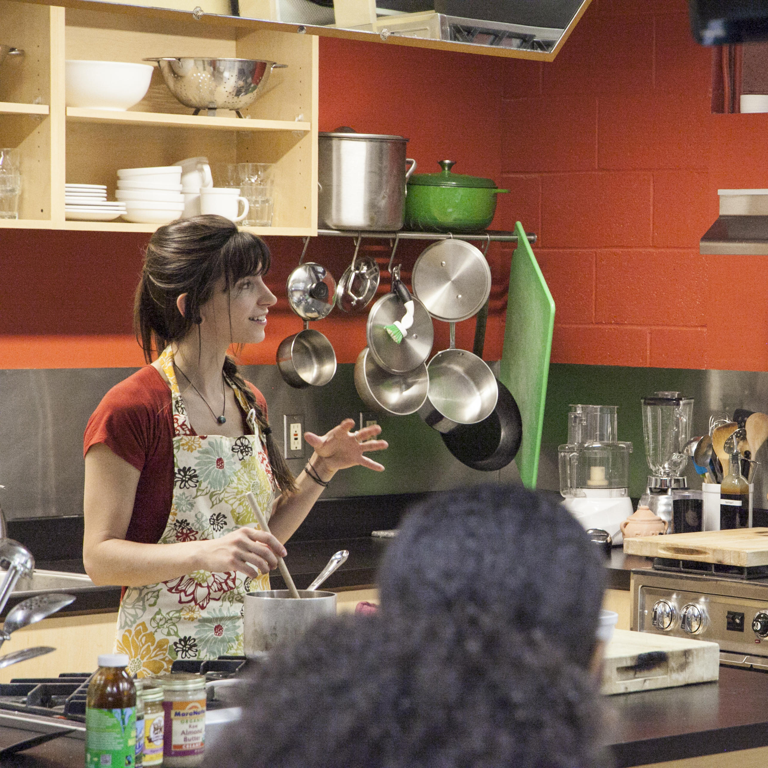 Student in kitchen giving demonstration